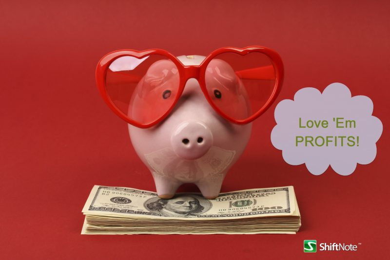 Piggy-bank-with-heart-sunglasses-standing-on-stack-of-money.jpg